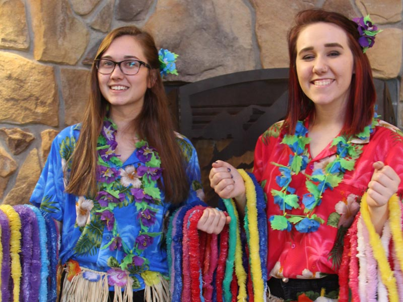 Two female staffs in their summer accessories at indoor waterpark | Timber Ridge Lodge