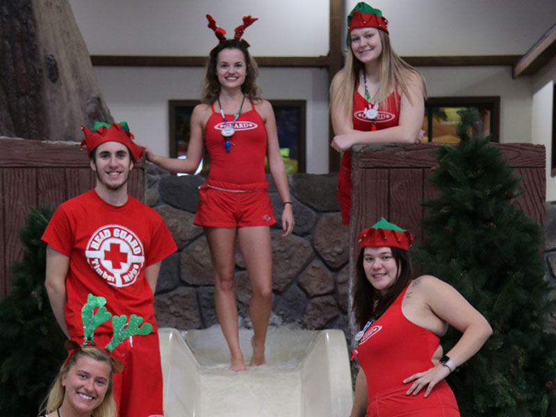 Timber Ridge Lodge lifeguard in Christmas outfits at an indoor waterpark