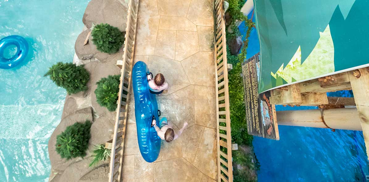 people walking to waterslide