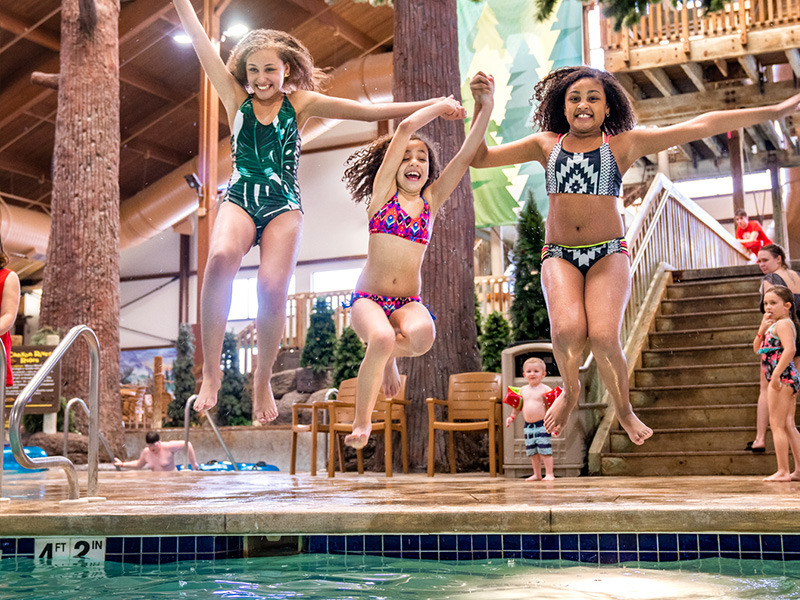 Girls Jumping into Pool