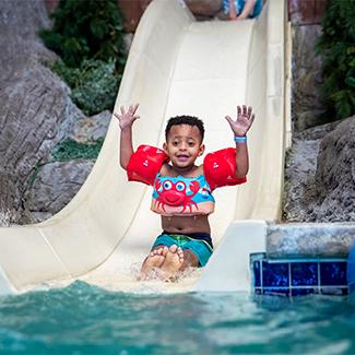 A Kid enjoying indoor water rides at Timber Ridge Lodge & Waterpark | Lake Geneva