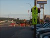 Crossing sign, cap in walk under flag