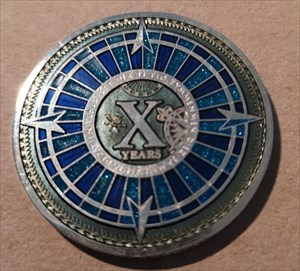 10 Years of Geocaching Multi Event Geocoin - ON fr
