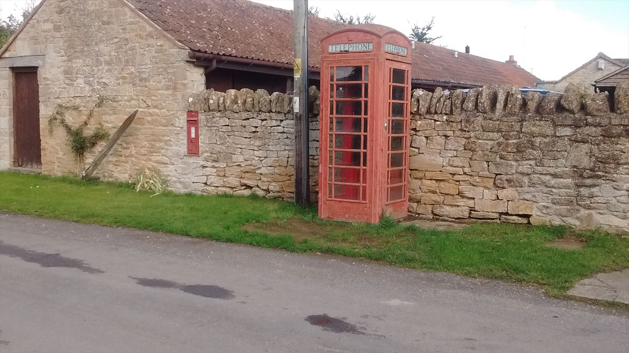 A picture of the phone box and post box