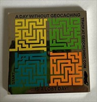 A Day Without Geocaching... Geocoin front