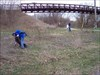 Moe the Sleaze and RJ picking up trash. log image