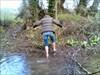 Cruella crossing the creek... BRRRRRRRR! log image