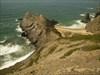 O rochedo e a praia log image
