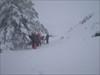 O grupo com a neve a cair.