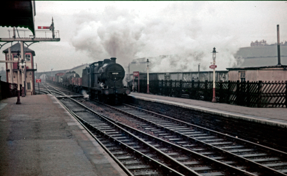 Locomotive 4F number 44124 at Romiley recorded by Ray Wood in the days of steam