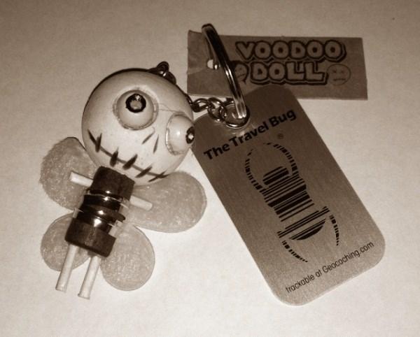 TB3M7Y6) Travel Bug Dog Tag - Zom-Bee VooDoo Doll