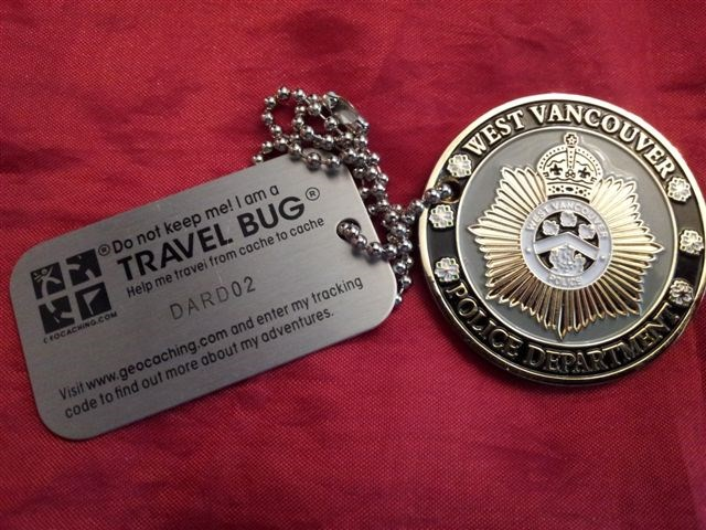 TB4Y4AB) Travel Bug Dog Tag - Police Challenge Coin