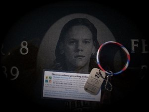 TB on Alex's grave marker