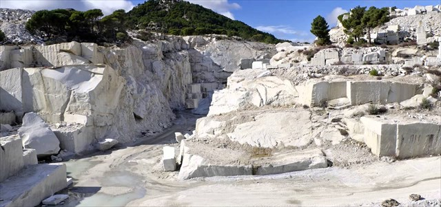 How is marble formed from limestone?