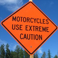 md+motorcycles_use_caution_sign