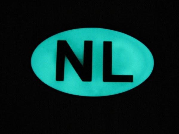 NL Geocoin at Night - front