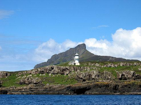 Eigg with An Sgurr - our target - beyond the lighthouse