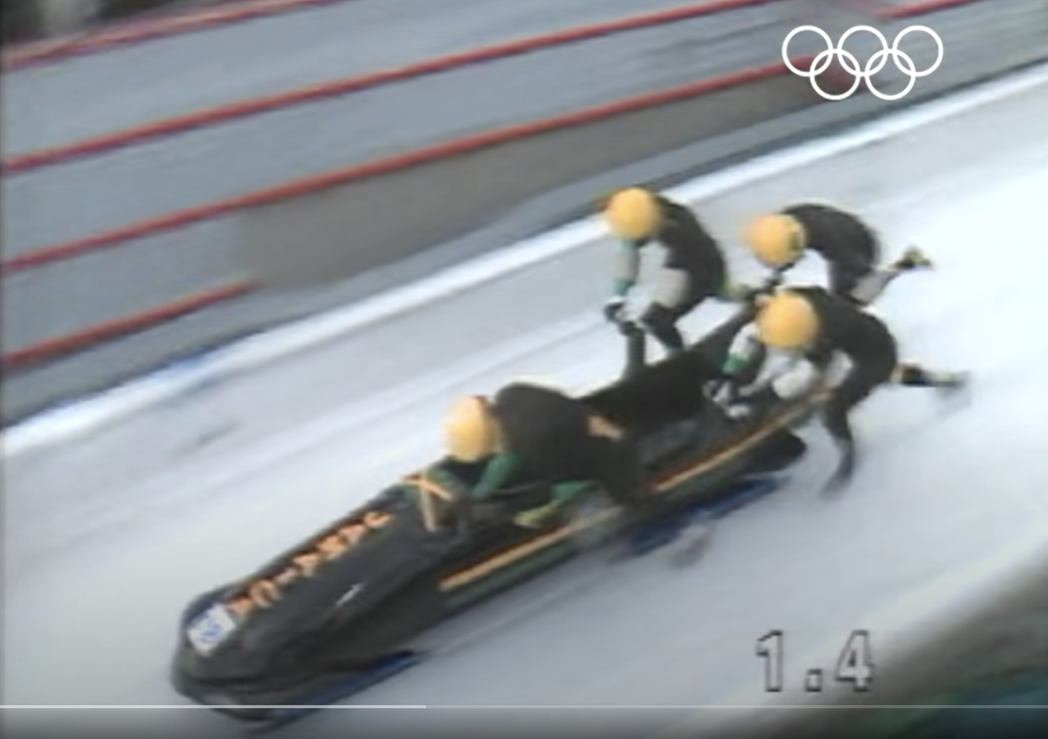 pic of Jamaican bobsledders starting down the track