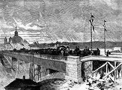 El primitivo viaducto de hierro y madera, en un grabado de 1874. Al fondo, se observa la Basílica de San Francisco el Grande.