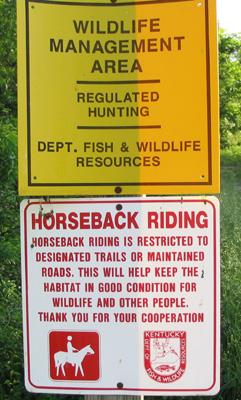 sign at the entrance - horseback riding allowed