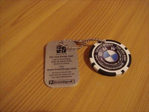 Tb1cx0r travel bug dog tag bmw world traveller poker chip this tb celebrates my 100th trackable item find it is a business card from bmw motorcycles of las vegas shaped like a casino poker chip colourmoves