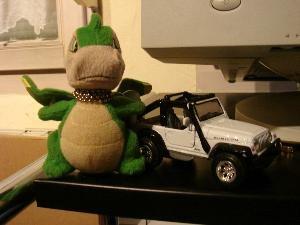 Small Grisu next to a jeep