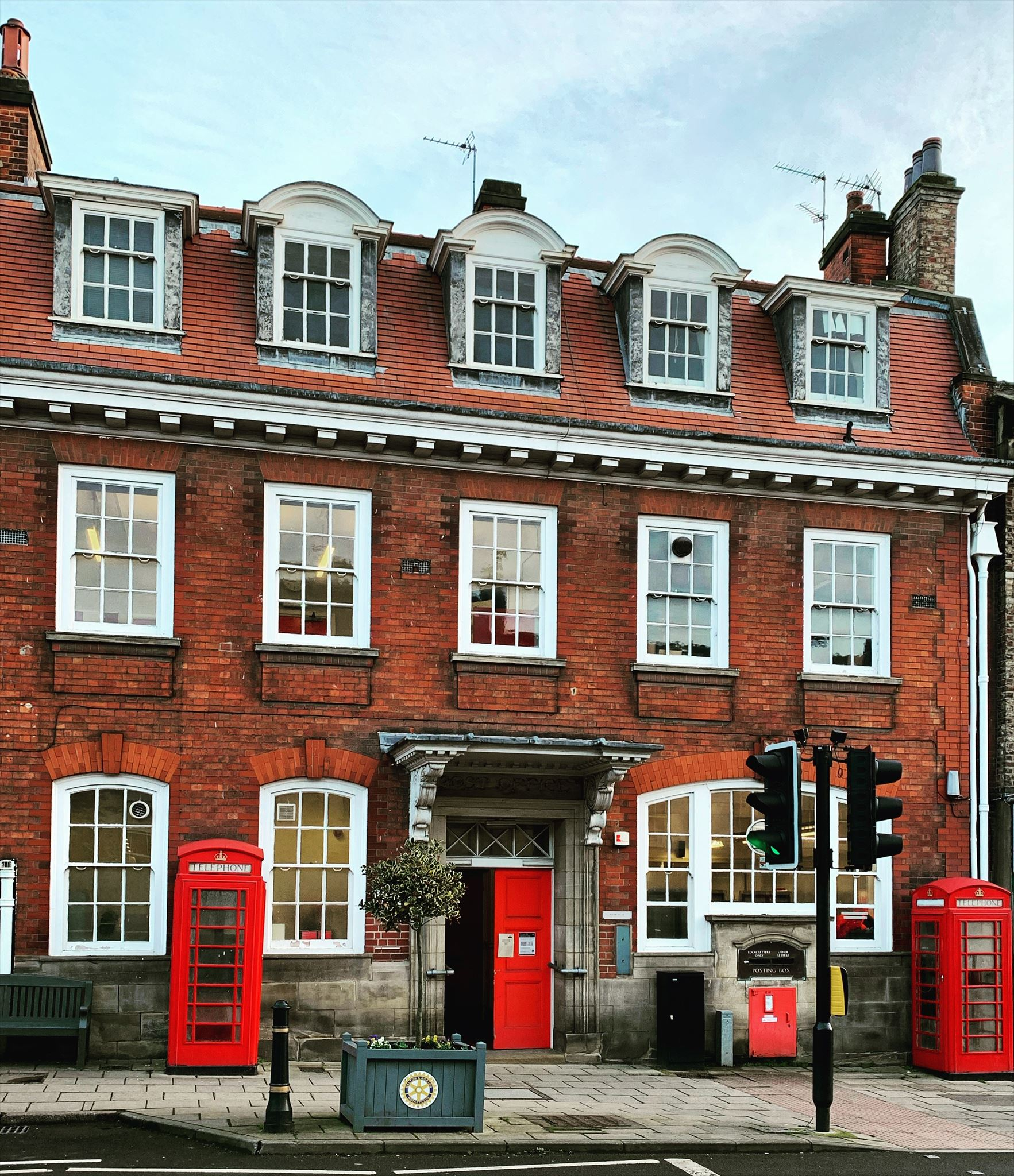A Fine Pair #1520. Post Office, Wheelgate Malton with 2 x red K6 telephone boxes and a red post box. c2020