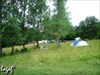 Tents pitched in he park.