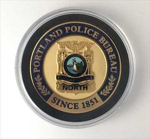 TB5EFW6) Travel Bug Dog Tag - Portland Police Bureau North
