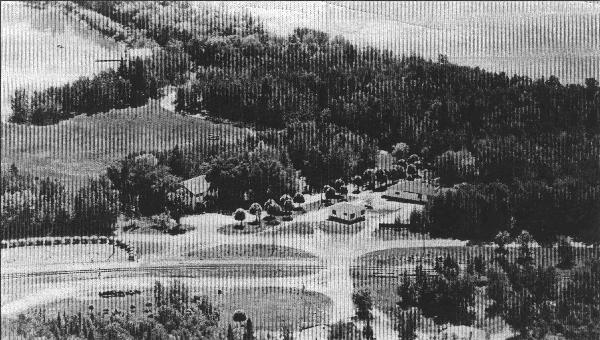 Aerial view from a vintage postcard. Across the railroad tracks are the Moonlight Inn and other stores. The building nearest the Moonlight is now the VB Library. On the far left is the Sports Field (former aerial field), and Pier Point is towards the upper left (beyond the edge of the photo).