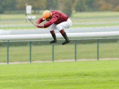 Jockey in air with no horse underneath him