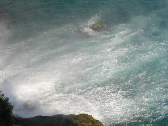 Sea under waterfalls