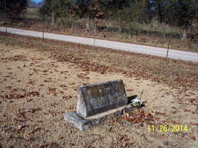 Homer E. Neely Centenarian Headstone, by MountainWoods. This context shot shows the headstone in relation to Farm Road 2120.