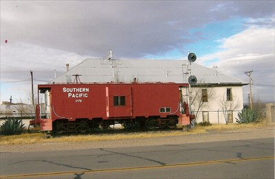 The building behind the caboose is the (now closed) Railroad Hotel