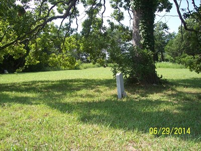 Fields Cemetery, by MountainWoods.  This is on the north side of YY.  There is one grave in the foreground, one way off in the background, and one all the way to the left at the west edge of the field.