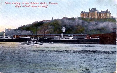 This postcard shows a view of the high school from Commencement Bay.  The view today is very similar, as the bluff prevents additional homes from being built.