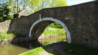 In this photograph you can see the white painted arch stones together with the vertical indicator for the centre of the canal.  The old roller to protect the bridge can be seen as can the lych gate on top of the bridge.