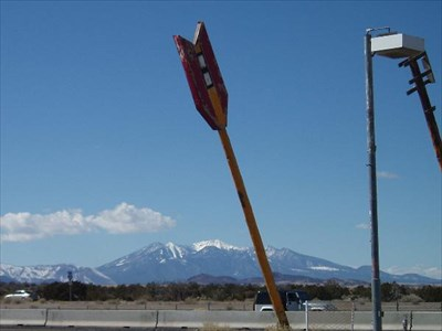 A lonely arrow and the majestic San Francisco Peaks