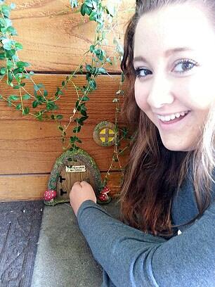 My daughter knocking on the Fairy's Door!
