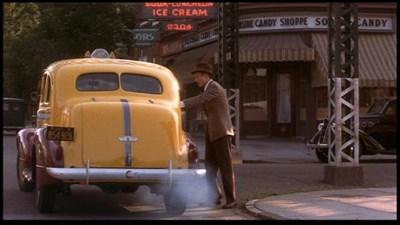 Robert Redford follows Glen Close outside Parkside Candy.