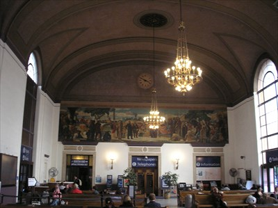 Interior shot of the station waiting room showing the mural on the wall.