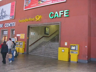 Walk to the west end of the train station and go up these steps to reach the Cafe Naser