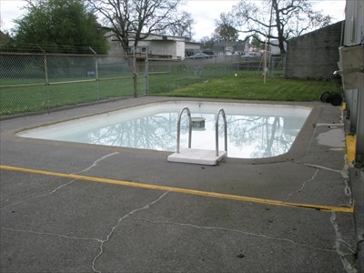 a wading pool outside, for toddlers to splash in, only open during the summer