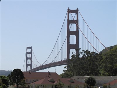 Golden Gate Bridge above the red roofs of Fort Baker buildings, Marin Headlands, CA