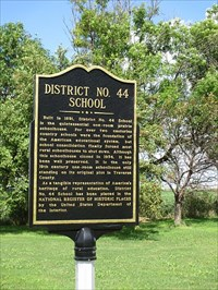 Describes significance of one-room schoolhouse