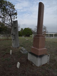 """Standing tall next to a """"WOWzilla,"""" a large Woodmen of the World monument for J.J. Lang."""