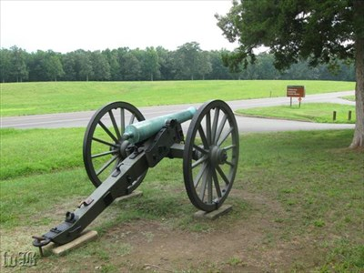 A cannon sits on Saunders Field at the entrance to the Wilderness Exhibit Shelter.