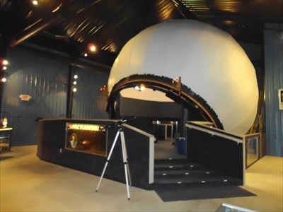 This photo shows the Kovac Planetarium mechanical globe and universe viewing area.