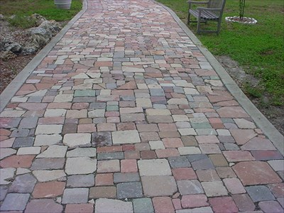 The cobblestone path was handmade by volunteers from donated bricks and stones.