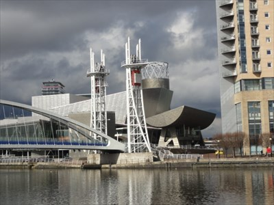 The art gallery is a very modern steel clad building and the bridge complements it.